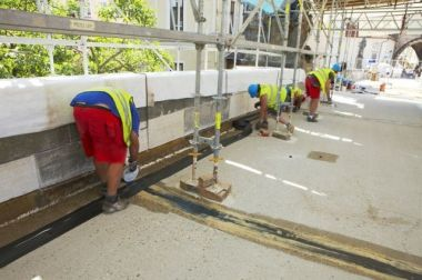 Laying of insulation strips on the bottom of the rail. | Charles Bridge museum